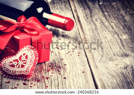 St Valentine's setting with present and red wine - stock photo