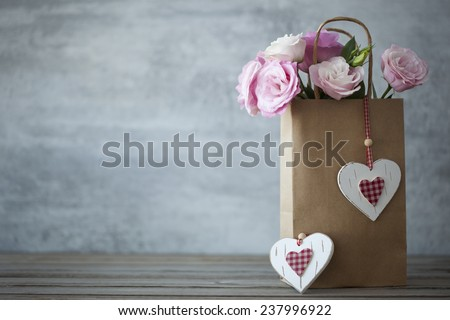 St. Valentines Day minimalistic background with pink flowers and hearts - stock photo