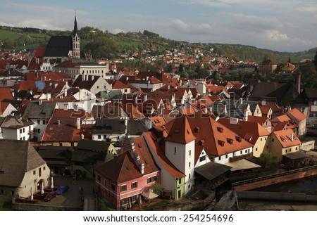 St Vitus Church over tiled roofs in Cesky Krumlov, South Bohemia, Czech Republic.  - stock photo