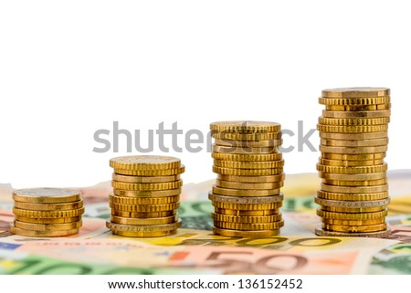 stack coins, rising curve, symbol photo for increasing profits and rising costs