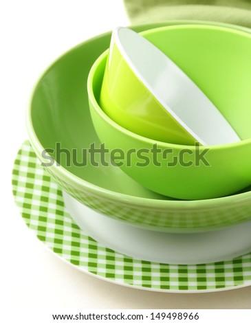 stack green kitchen utensils  on a white background - stock photo