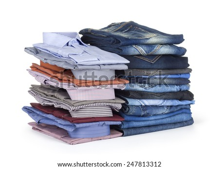 stack Jeans and  dress shirts on white background - stock photo