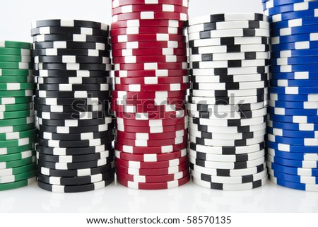 Stack of a poker chips on white background - stock photo