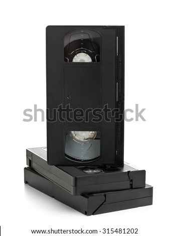 Stack of analog video home system (VHS) tape over white background - stock photo