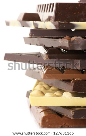 Stack of assorted chocolate bars on white background.