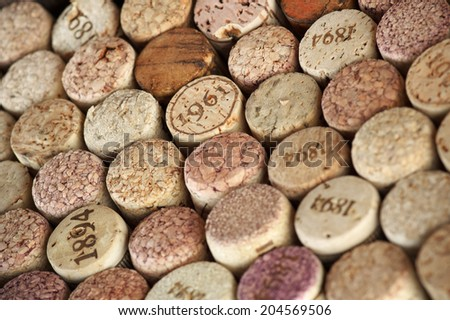 Stack of assorted wine corks close-up.