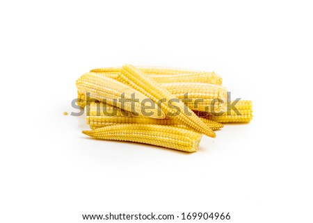 Stack of baby corn cobs isolated on white background - stock photo