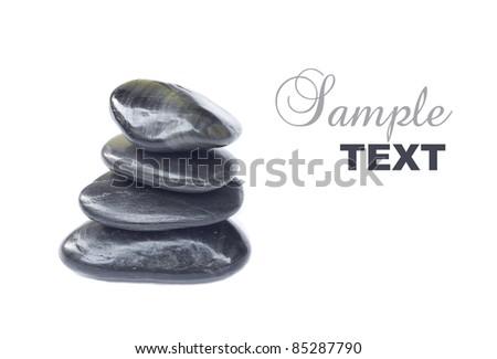Stack of balanced zen stones isolated on white background - stock photo