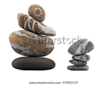 stack of balanced zen stones isolated on white background (CLIPPING PATH) - stock photo