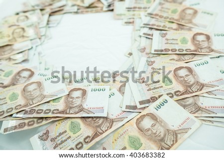 stack of 1000 bath Thai money : Thailand Currency 1000 Bath, BankNotes isolated on white background. with copy space and text here  - stock photo