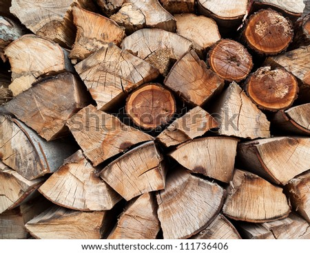 Stack of beech chopped firewoods prepared for winter - stock photo
