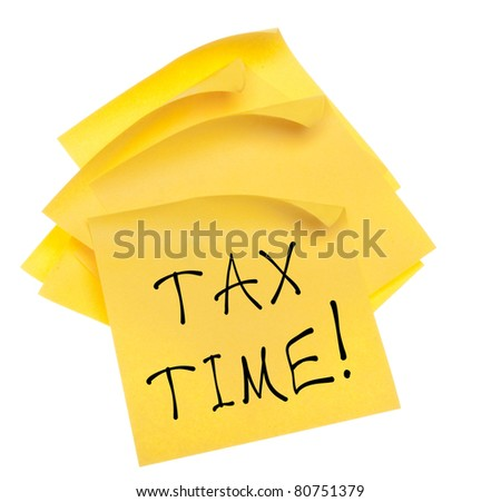 Stack of Blank Yellow Sticky Notes with Edges Curled and Tax Time Message.  Isolated on White with a Clipping Path. - stock photo
