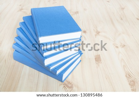 Stack of blue books on wooden floor