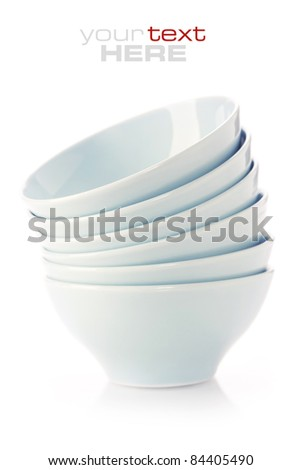 Stack of blue bowls over white (with sample text) - stock photo