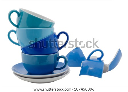 Stack of blue Coffee Cups and one broken cup, isolated on white
