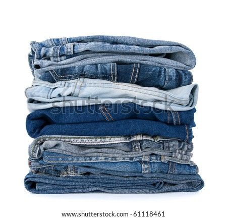Stack of blue denim clothes on white background, jeans and jacket. - stock photo
