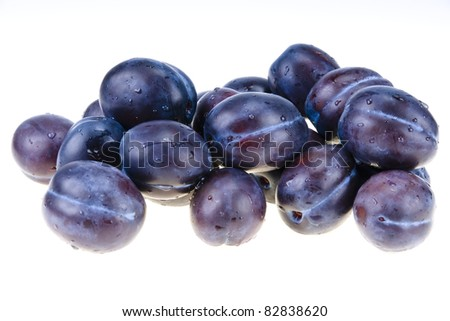 Stack of blue plums isolated