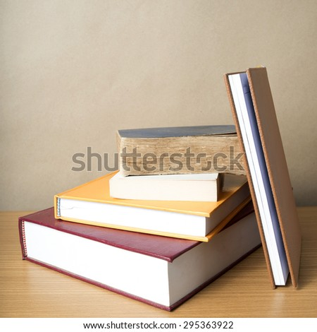 stack of book on wood table background
