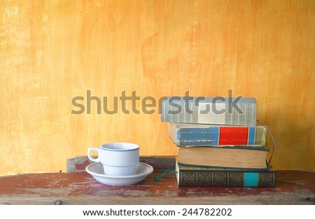 stack of books and a cup of coffee,free copy space - stock photo