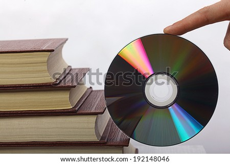 stack of books and CD-ROM - stock photo