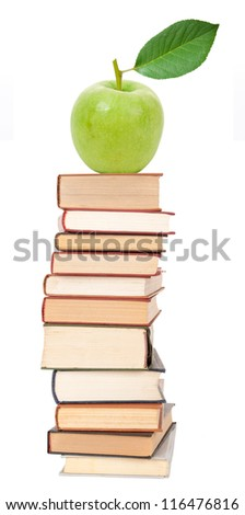 Stack of books and green apple - stock photo