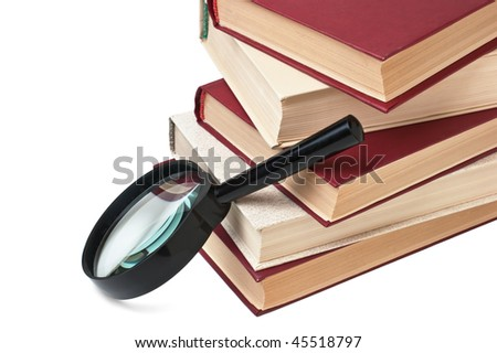 stack of books and magnifying glass isolated on a white