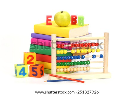 stack of books, apple and abacus over white - stock photo