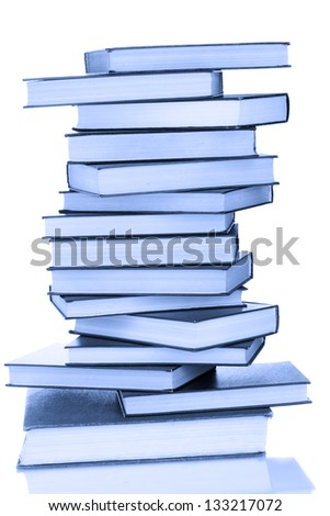 Stack of books in blue light