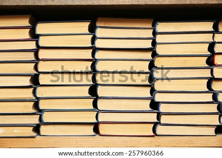 Stack of books in library - stock photo