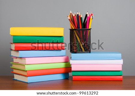 Stack of books on a gray background