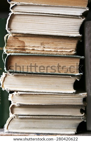 Stack of books on bookshelf, closeup - stock photo