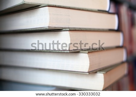 Stack of Books on Shelf - stock photo