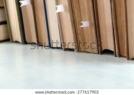 Stack of books on table close up - stock photo