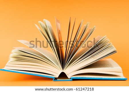 Stack of books on the color background - stock photo