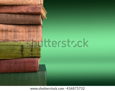 Stack of books on the color gradient background, space for text - stock photo