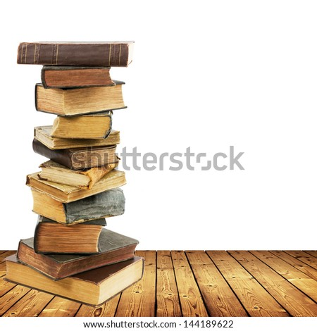 stack of books on wood planks isolated on white