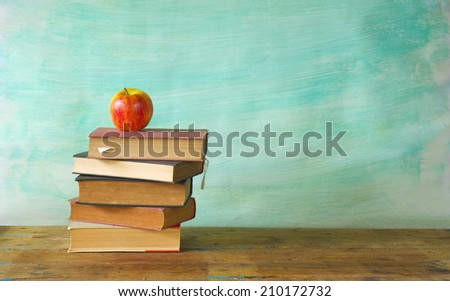 stack of books with an apple, learning concept, free copy space  - stock photo