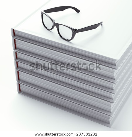 Stack of books with black glasses - stock photo