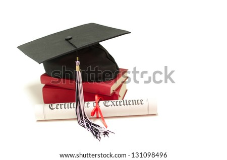 Stack of books with cap and diploma on white background - stock photo