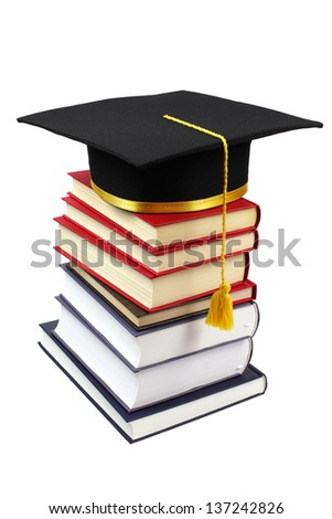 Stack of books with graduation cap isolated on white background