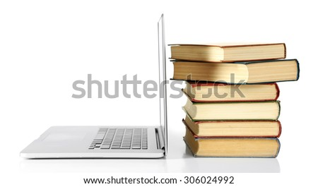 Stack of books with laptop close up