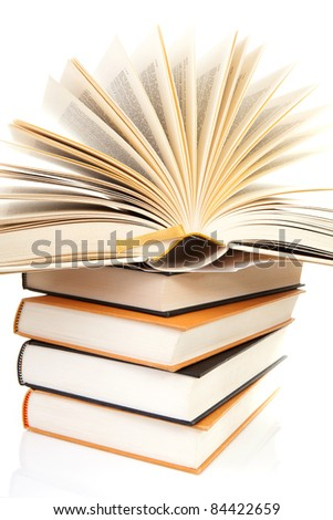 stack of books with open book over white background