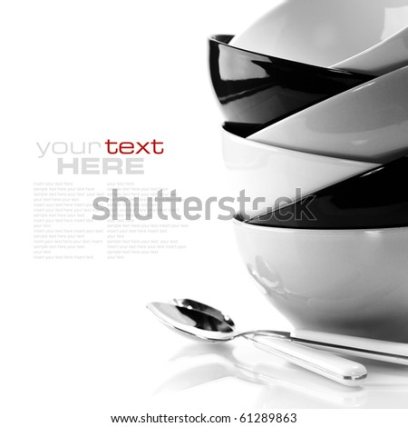 Stack of bowls and spoons. Black and white image (with sample text)