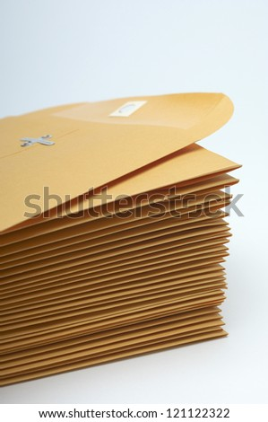 Stack of brown confidential paper folders over white background - stock photo