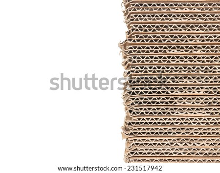 Stack of brown corrugated cardboard boxes isolated on white background with copy space. Edge view of flattened boxes. Nice for new packaging or recycling concept.  - stock photo