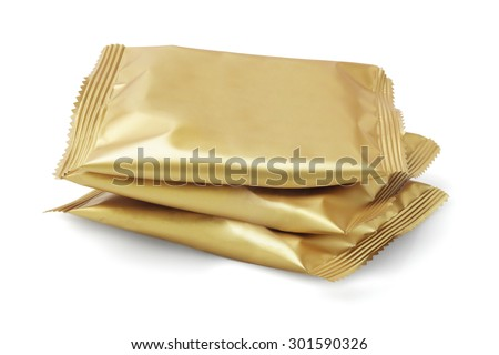 Stack of Candy in Sealed Golden Colour Wrappers on White Background - stock photo