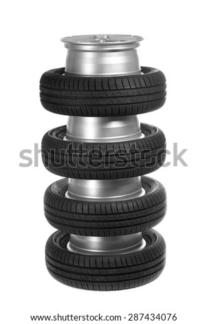 Stack of car wheels and tires. Isolate on white. - stock photo
