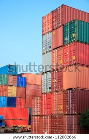 Stack of Cargo Containers at sunrise in an intermodal yard - stock photo