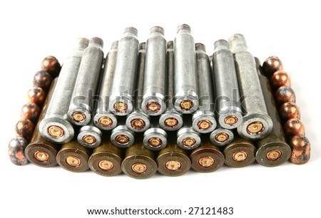 Stack of cartridge case of different weapons and pistol bullets - stock photo