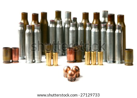 Stack of cartridge case of different weapons and pistol bullets